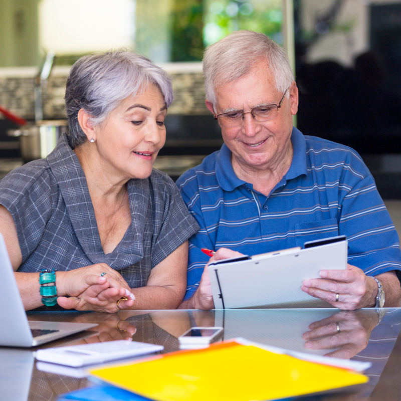 Older man and woman looking at paperwork